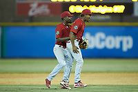 Johnson City Cardinals second baseman Moises Castillo (right) celebrates with shortstop Luis Flores (16) after the last out of the game against the Burlington Royals at Burlington Athletic Stadium on July 15, 2018 in Burlington, North Carolina. The Cardinals defeated the Royals 7-6.  (Brian Westerholt/Four Seam Images)