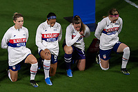 ORLANDO CITY, FL - FEBRUARY 18: Abby Dahlkemper #7, Lynn Williams #6, Alyssa Naeher #1 and Becky Sauerbrunn #4 take a knee during the National Anthem during a game between Canada and USWNT at Exploria stadium on February 18, 2021 in Orlando City, Florida.