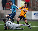 Forfar keeper Darren Hill saves at the feet of Alloa's Martin Grehan.