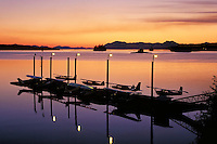Float planes tied to a seaplane dock along the Tongass Narrows, Ketchikan, Alaska at sunset. Ketchikan is the regional hub of the southern part of the Inside Passage, and float planes are key means of transportation between the island communities of f Sou