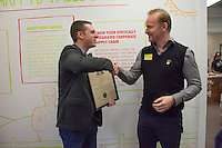 """Wolf Starr of Connect Columbus shakes hands with Morgan Spurlock before presenting his with a proclamation from the state of Ohio congratulating him on the opening of his new restaurant.<br /> <br /> Morgan Spurlock opens """"Holy Chicken,"""" a faux fast food restaurant in Columbus, Ohio, where a documentary crew recorded his interaction with customers who thought they were dining at a new type of fast food restaurant. However, the entire location was designed to be part of his documentary highlighting the marketing of food that may not be as healthy as it is stated in advertisement, banners, and notices at the restaurant."""