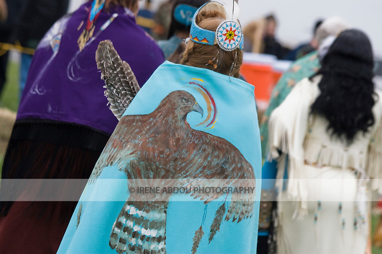A Native American dresses in full traditional regalia at the Healing Horse Spirit PowWow in Mt. Airy, Maryland.