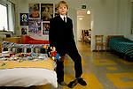 Wymondham College in Norfolk State run boarding school.1990s UK   Teen boy in dormitory holding a soft toy. 1991