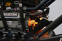 May 17, 2014; Commerce, GA, USA; Detailed view of fire from the engine of NHRA top fuel dragster Terry McMillen during qualifying for the Southern Nationals at Atlanta Dragway. Mandatory Credit: Mark J. Rebilas-USA TODAY Sports
