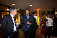 08-02-12, Netherlands,Tennis, Den Bosch, Daviscup Netherlands-Finland, Official Dinner, KNLTB voorzitter Rolf Thung(L) in gesprek met oud Daviscup speler en huidig kledingsponsor Sjeng Schalken.
