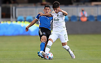 SAN JOSE, CA - MAY 15: Cristian Espinoza #10 of the San Jose Earthquakes and Claudio Bravo #5 of the Portland Timbers FC battle for the ball during a game between Portland Timbers and San Jose Earthquakes at PayPal Park on May 15, 2021 in San Jose, California.