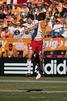 New York Red Bulls defender Andrew Boyens (27) and Houston Dynamo forward Kei Kamara (10).  New York Red Bulls defeated Houston Dynamo 3-0 for an aggregate  score of 4-1 over Houston Dynamo   at Robertson Stadium in Houston, TX on November 9, 2008 in the second leg of the Western Conference semifinals.  Photo by Wendy Larsen/isiphotos.com