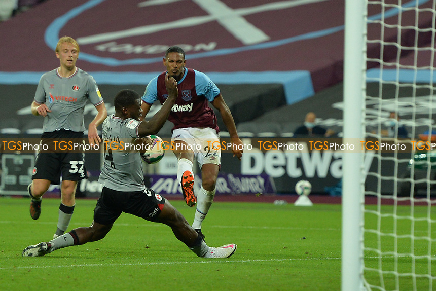 Sebastien Haller of West Ham United shot is blocked by Adedeji Oshilaja of Charlton Athletic FC during West Ham United vs Charlton Athletic, Caraboa Cup Football at The London Stadium on 15th September 2020