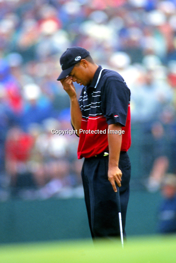 Tiger Woods reaction to missing a put on the 17th green of the final round of the 1999 Players Championship.