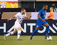 PHILADELPHIA, PA - JUNE 30: Paul Arriola #7 chases Gevaro Nepomuceno #11 during a game between Curaçao and USMNT at Lincoln Financial Field on June 30, 2019 in Philadelphia, Pennsylvania.