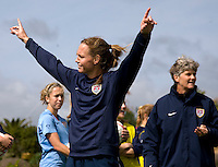 USWNT captain Christie Rampone shows she is happy with her effort during a team competition at practice for the Algarve Cup in Albufeira, Portugal.