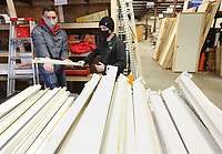 Kaden Woodworth (left) and Keaton Wilson, both elders with The Church of Jesus Christ of Latter-Day Saints, sort Friday, January 8, 2021, the industrial shelving at the Benton County Habitat for Humanity ReStore in Bentonville. The two were volunteering at the store  that is open Monday through Saturday. Check out nwaonline.com/210109Daily/ and nwadg.com/photos for a photo gallery.<br /> (NWA Democrat-Gazette/David Gottschalk)
