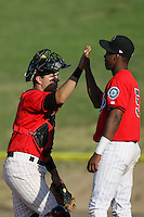 May 16, 2010: Trevor Coleman of the High Desert Mavericks greets teammate Luis Nunez after win against the Stockton Ports at Mavericks Stadium in Adelanto,CA.  Photo by Larry Goren/Four Seam Images