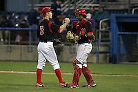 Batavia Muckdogs pitcher Keith Butler gets congratulations from catcher Audry Perez during a game vs. the Auburn Doubledays at Dwyer Stadium in Batavia, New York September 3, 2010.   Batavia defeated Auburn 8-5.  Photo By Mike Janes/Four Seam Images