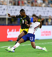DALLAS, TX - JULY 25: Kellyn Acosta #23 of the United States attempts to strip the ball from Cory Burke #9 of Jamaica during a game between Jamaica and USMNT at AT&T Stadium on July 25, 2021 in Dallas, Texas.