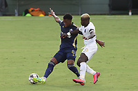 CARY, NC - AUGUST 01: Dre Fortune #8 is challenged by Anderson Asiedu #6 during a game between Birmingham Legion FC and North Carolina FC at Sahlen's Stadium at WakeMed Soccer Park on August 01, 2020 in Cary, North Carolina.
