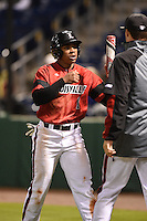 Louisville Cardinals outfielder Corey Ray (2) after scoring a run during a game against the USF Bulls on February 14, 2015 at Bright House Field in Clearwater, Florida.  Louisville defeated USF 7-3.  (Mike Janes/Four Seam Images)