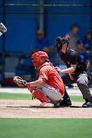 GCL Phillies West catcher Abrahan Gutierrez (3) waits to receive a pitch in front of home plate umpire Ryne Sigmon during a game against the GCL Blue Jays on August 7, 2018 at Bobby Mattick Complex in Dunedin, Florida.  GCL Blue Jays defeated GCL Phillies West 11-5.  (Mike Janes/Four Seam Images)