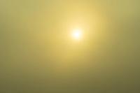 Sun in fog . Derry, Ireland