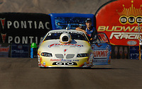 Apr 8, 2006; Las Vegas, NV, USA; NHRA Pro Stock champion Greg Anderson, driver of the Summit Racing Pontiac GTO returns to his pit area after qualifying for the Summitracing.com Nationals at Las Vegas Motor Speedway in Las Vegas, NV. Mandatory Credit: Mark J. Rebilas