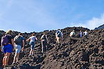 Tour group climb the scorching hot lava fields of Volcan de Pacaya in Guatemala