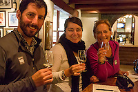 South Africa, Paarl area, near Cape Town.  Tourists enjoying a wine-tasting session at Fairview winery.  MR.