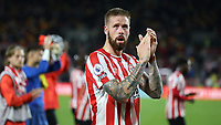 Brentford captain, Pontus Jansson applauds the home fans at the end of the match during Brentford vs Liverpool, Premier League Football at the Brentford Community Stadium on 25th September 2021