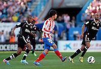 Atletico's Oliver and Granada's brahimi and Mikel Rico during La Liga BBVA match. April 14, 2013.(ALTERPHOTOS/Alconada)