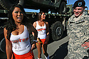 Army reservist Sgt. Matt Corbet accompanys some representatives from Hooters restaurant before a deployment ceremony at Camp Pendleton in 2009.  for the North County Times
