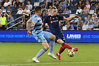KANSAS CITY, KS - SEPTEMBER 11: Andreu Fontas #3 of Sporting Kansas City tries to keep up with Robert Beric #27 of Chicago Fire FC during a game between Chicago Fire FC and Sporting Kansas City at Children's Mercy Park on September 11, 2021 in Kansas City, Kansas.