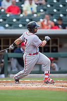 Jhonatan Solano (23) of the Syracuse Chiefs follows through on his swing against the Charlotte Knights at BB&T BallPark on June 1, 2016 in Charlotte, North Carolina.  The Knights defeated the Chiefs 5-3.  (Brian Westerholt/Four Seam Images)