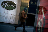 NEW YORK, NY - NOVEMBER 18:  A man walks in front of Pfizer headquarters on November 18, 2020 in New York. The drug maker company Pfizer inform that its Covid-19 vaccine is  95 percent effective with no serious side effects while Coronavirus cases skyrocket around the globe. (Photo by Eduardo MunozAlvarez/VIEWpress)