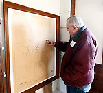Roxbury, CT- 27 December 2013-122813CM11-  COUNTRY LIFE ONLY PLEASE--- Bill Steers, with the board of directors for the Roxbury Land Trust looks at a historical map of Roxbury inside the Good Hill School house during an open house in Roxbury on Saturday afternoon.    Christopher Massa Republican-American