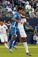 Milton Molina (2) El Salvador goes up for a header with (13)  Eddie Hernandez Honduras... Honduras defeated El Salvador 3-2 after extra time to go through to the final at LIVESTRONG Sporting Park, Kansas City, Kansas.