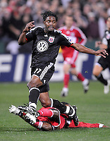 DC United  forward Luciano Emilio (11) being tackled by Chicago Fire forward Patrick Nyarko (14) ,Chicago Fire tied DC United 1-1 at  RFK Stadium, Saturday March 28, 2009.