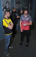 From left, Dane Coles, Lions coach Johan Ackerman, Hurricanes coach Chris Boyd and Lions captain Warren Whiteley chat before the captains' photo, with the Super Rugby Trophy on the evening before the final between the Hurricanes and Lions Super Rugby teams, at Westpac Stadium, Wellington, New Zealand on Friday, 5 August 2016. Photo: Dave Lintott / lintottphoto.co.nz