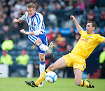 GLASGOW, SCOTLAND - JANUARY 28:  Kilmarnock's Dean Shiels second half shot as  Ayr's John Robertson defends during the Scottish Communities Cup Semi Final match between Ayr United and Kilmarnock at Hampden Park on January 28, 2012 in Glasgow, United Kingdom. (Photo by Rob Casey/Getty Images).
