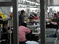 Workers in a factory in Shanghai, China, that makes goods for many manufacturers including Umbro. The factory is a sweat-shop where workers are paid around 50 pounds per month..12 Apr 2005