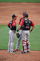 World Team pitching coach David Rosario (50) talks with pitcher Jarlin Garcia (33) and catcher Elias Diaz (29) during the MLB All-Star Futures Game on July 12, 2015 at Great American Ball Park in Cincinnati, Ohio.  (Mike Janes/Four Seam Images)