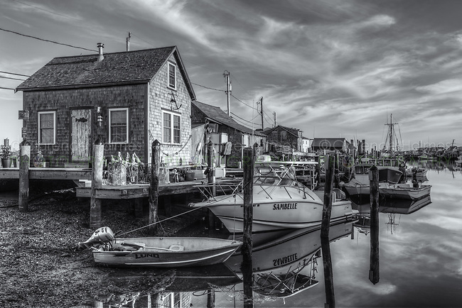 The commercial fishing village of Menemsha and boats docked in Menemsha Basin during the first hour after sunrise, in Chilmark, Massachusetts on Martha's Vineyard.