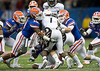 01 January 2010:  Will Hill of Florida and Cade Holliday of Florida tackle Mardy Gilyard of Cincinnati during the game during Sugar Bowl at the SuperDome in New Orleans, Louisiana.  Florida defeated Cincinnati, 51-24.