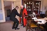"""Hercules Clay Penny Loaf Day. The Mayor of Newark Tom Bickley, being robed up, before meeting guests. Newark-on-Trent,  Nottinghamshire UK 2015.<br /> <br /> Hercules Clay Penny Loaf Day. Hercules Clay a wealthy cloth merchant who was a former Newark businessman and in 1644 Royalist Mayor of the town during the English Civil War. For three nights in a row he dreampt of his house burning and he took this as an omen, moving out just before the house was indeed damaged by a """"grenado"""", a mortar shell fired by the besieging Parliamentary forces.  He died in 1645, and in his Will he left a legacy providing for an annual sermon in which the preacher was to 'exhort the people not to set their affections on things of this world but by their good works to lay … hold on eternal life', and for bread to be distributed to the poor."""