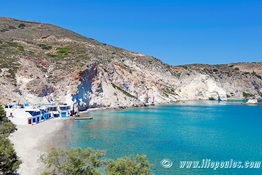 """Traditional fishermen houses with the impressive boat shelters, also known as """"syrmata"""" in Firopotamos of Milos, Greece"""