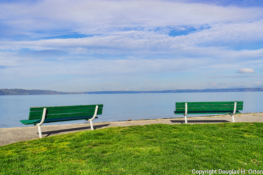 Benches along beach at Dash Point Park, on Puget Sound.  A City of Tacoma Metro Parks park near Dash Point State Park.  Dash Point is a historic Mosquito Fleet steam ship stop.