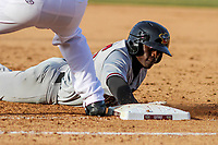 Quad Cities River Bandits outfielder Daz Cameron (16) dives back to first base during a Midwest League game against the Wisconsin Timber Rattlers on April 8, 2017 at Fox Cities Stadium in Appleton, Wisconsin.  Wisconsin defeated Quad Cities 3-2. (Brad Krause/Four Seam Images)