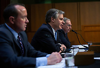 Director of the Federal Bureau of Investigation Christopher Wray, joined by Under Secretary at the U.S. Department of Homeland Security David Glawe and Acting Director of the National Counterterrorism Center Russell Travers, testifies before the U.S. Senate Committee on Homeland Security and Governmental Affairs on Capitol Hill in Washington D.C., U.S., on Tuesday, November 5, 2019.<br />  <br /> Credit: Stefani Reynolds / CNP /MediaPunch
