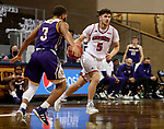SIOUX FALLS, SD - MARCH 6: Kruz Perrott-Hunt #5 of the South Dakota Coyotes drives with the ball against Justin Brookens #3 of the Western Illinois Leathernecks during the Summit League Basketball Tournament at the Sanford Pentagon in Sioux Falls, SD. (Photo by Dave Eggen/Inertia)