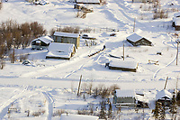 Aerial of John Baker arriving @ Nulato chkpt during 2006 Iditarod Alaska Winter