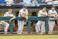 Michigan Wolverines dugout: Riley Bertram (12), Jack Bredeson (34), Dominic Clementi (13) and Jack Weisenburger (48) during Game 2 of the NCAA College World Series Finals on June 25, 2019 at TD Ameritrade Park in Omaha, Nebraska. Vanderbilt defeated Michigan 4-1. (Andrew Woolley/Four Seam Images)
