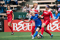 Seattle, WA - Saturday May 13, 2017: Whitney Church and Megan Rapinoe during a regular season National Women's Soccer League (NWSL) match between the Seattle Reign FC and the Washington Spirit at Memorial Stadium.